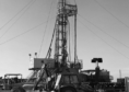 Rig silhouetted against sky