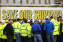Harland and Wolff workers listen to union officials from Unite and GMB during an occupation of the shipyard in Belfast in a campaign to save it. Liam McBurney/PA Wire
