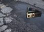 The reflection an Exxon sign is caught in a puddle at an Exxon gas station in Nashport, Ohio on January 26, 2018. Ty Wright/Bloomberg News