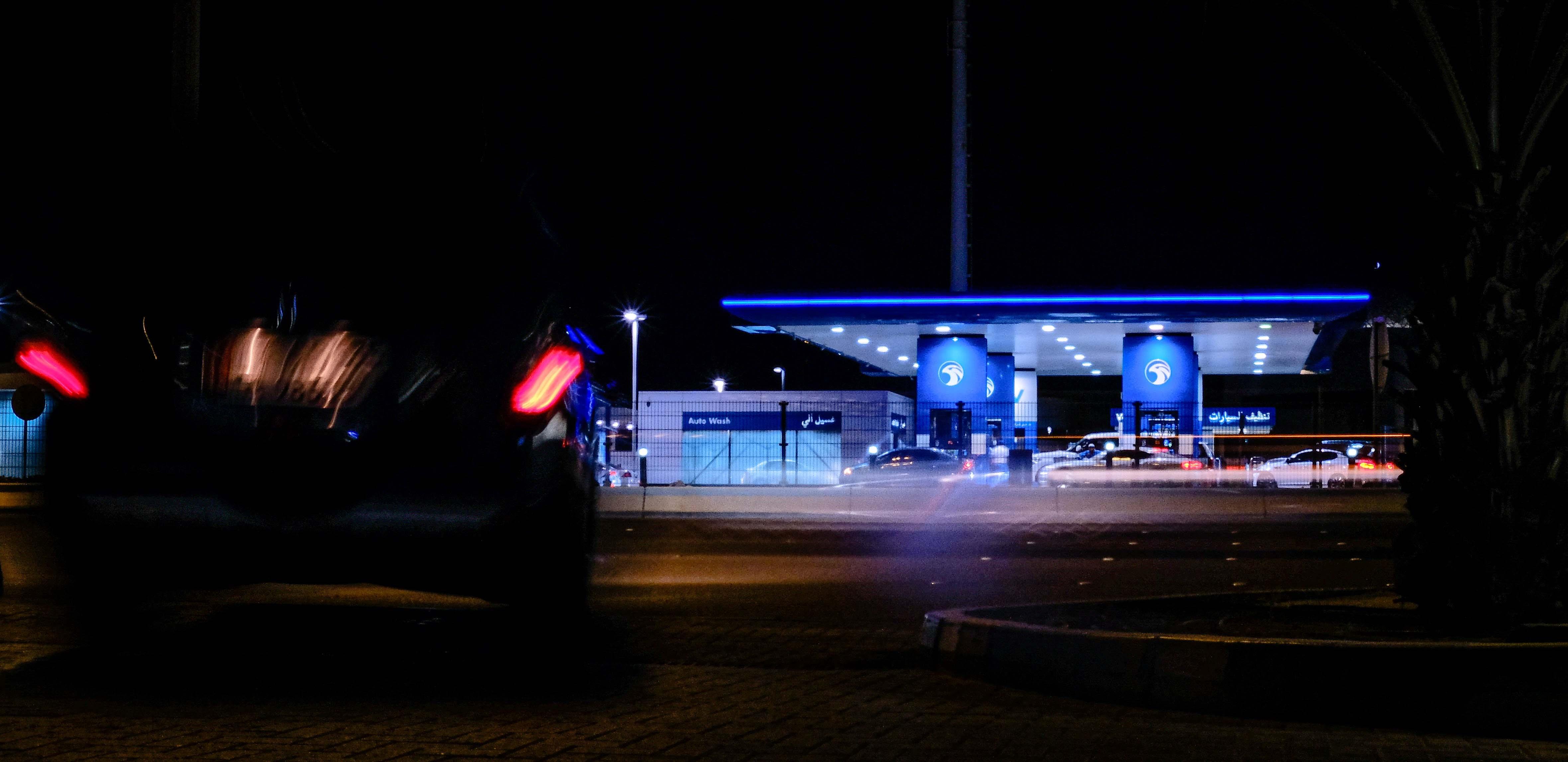 Adnoc fuel station lit up at night