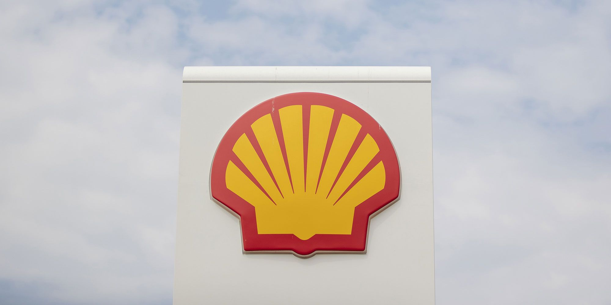 A Shell logo sits on a sign at a gas station, operated by Royal Dutch Shell Plc., in Rotterdam, Netherlands, on Wednesday, July 25, 2018. Photographer: Jasper Juinen/Bloomberg