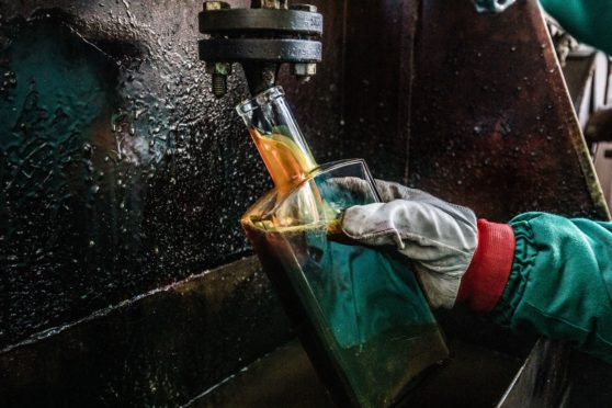 MOL employee takes samples in the Duna oil refinery, operated by MOL Hungarian Oil & Gas Plc, in Szazhalombatta, Hungary, on Wednesday, February 13, 2019.