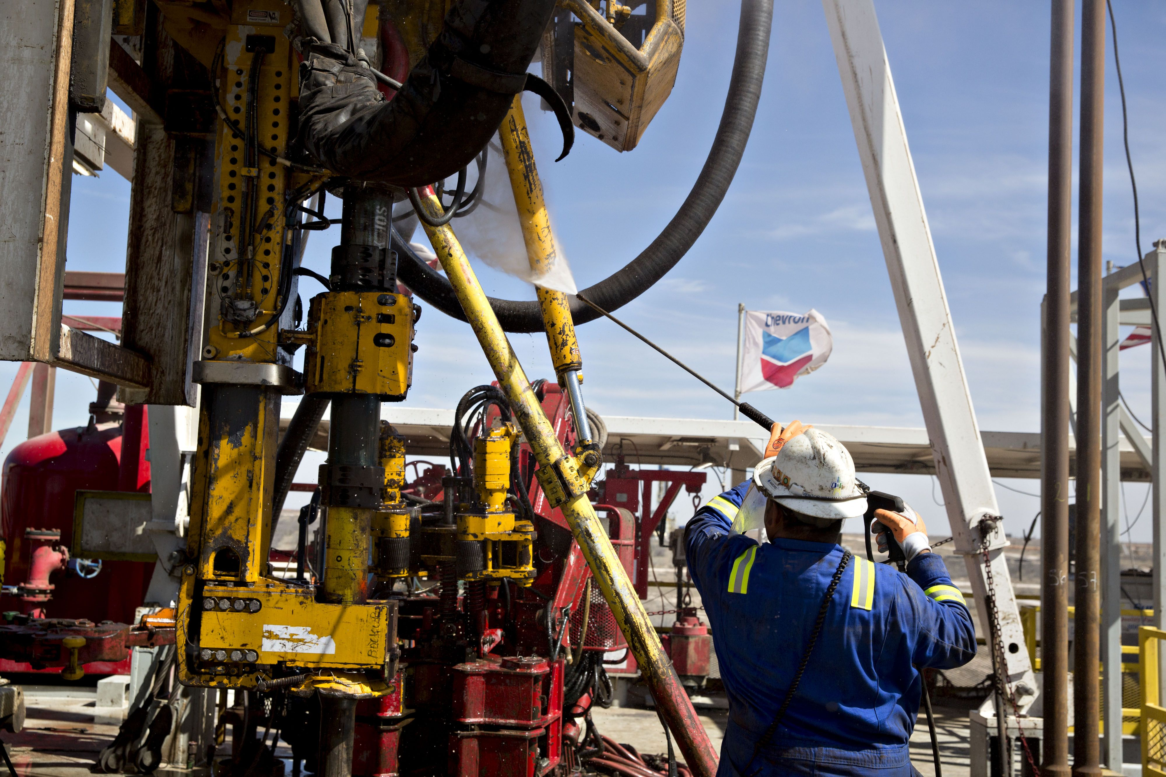 A roughneck with Nabors Industries Ltd. uses a power washer to clean the drilling floor of a Nabors rig drilling for Chevron Corp. in the Permian Basin near Midland, Texas, U.S., on Thursday, March 1, 2018. Photographer: Daniel Acker/Bloomberg