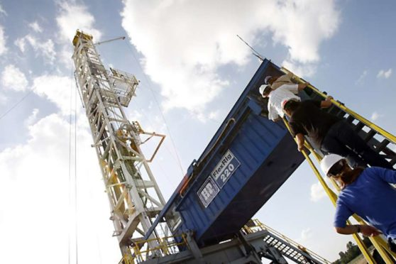 A Devon Energy flex-drilling rig reaches the blue sky Tuesday, June 10, 2008, near Denton. The company's hosts operations in the Barnett Shale, which is the largest natural gas play in Texas; and second on the boom in natural gas shale operations in the U.S. ( Kevin Fujii / Chronicle )