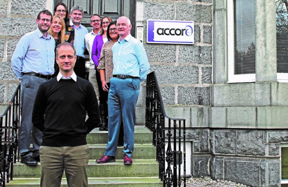 Accord Energy Solutions managing director James Arthur, front, with some of the firm's staff.