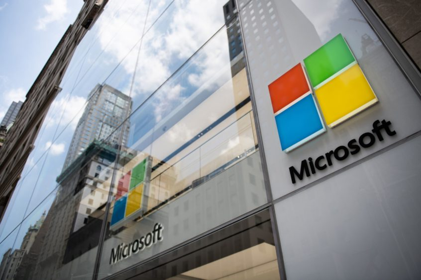 major oil companies have teamed up with technology partners such as Google, Microsoft or Amazon in order to automate their exploration services. A sign hangs on the exterior of the Microsoft Corp. Fifth Avenue flagship store in New York, U.S., on Saturday, July 14, 2018. Mark Kauzlarich/Bloomberg