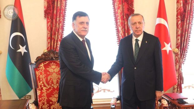 Turkish President Recep Tayyip Erdogan shakes hands with GNA Prime Minister Fayez al-Serraj on the ceasefire in Libya
