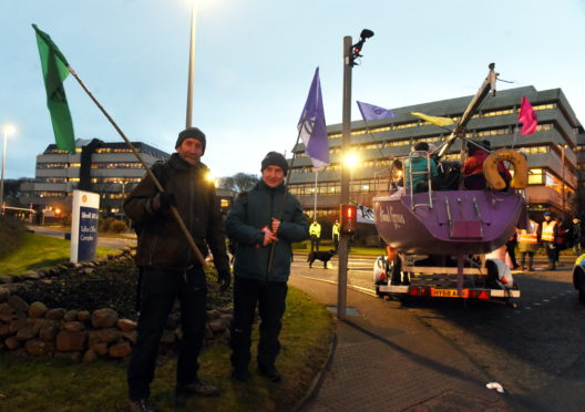 Extinction Rebellion Scotland blocking entrance to the headquarters of the oil giant Shell, Altens, Aberdeen.  Picture by Jim Irvine  16-1-20