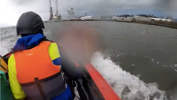 Extinction Rebellion activists approaching an oil rig in Dundee port.