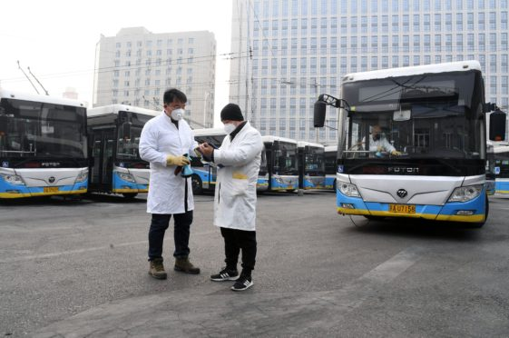 Staff members record the disinfecting log at a bus station in Beijing Coronavirus outbreak, China - 27 Jan 2020 Photo by CHINE NOUVELLE/SIPA/REX/Shutterstock (10540390b)