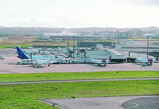 Loganair operated planes at Aberdeen International Airport.