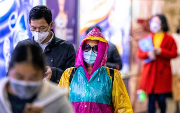 Photo by ALEX PLAVEVSKI/EPA-EFE/Shutterstock (10554637r) People in subway wearing protective masks.