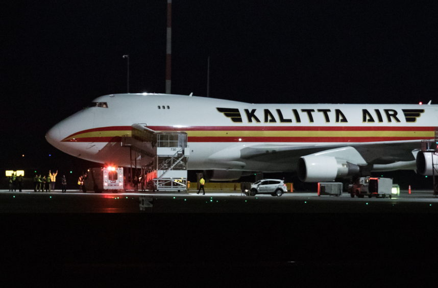 Mandatory Credit: Photo by Canadian Press/REX/Shutterstock (10550733g) A Kalitta Air plane chartered by the United States government carrying U.S. and Canadian citizens home from Wuhan, China, arrives at Vancouver International Airport in Richmond, B.C. to refuel before continuing on to a U.S. Air Force Base Coronavirus outbreak, Richmond, Canada - 07 Feb 2020 Canadians on the flight deplaned and boarded a smaller charter for a flight to CFB Trenton