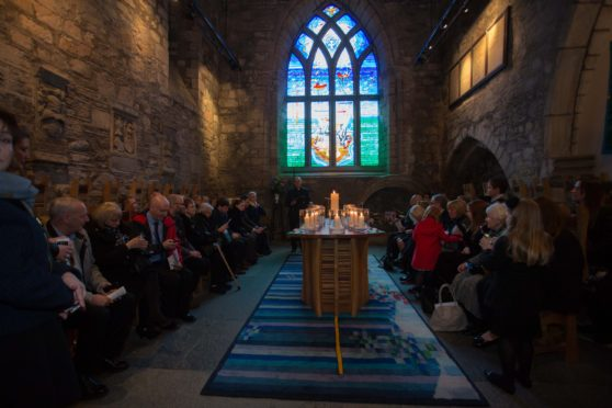 A prayer held in the Kirk of St Nicholas in Aberdeen in 2014, marking the fifth anniversary of the 2009 crash. Picture by Michal Wachucik/Newsline Media Ltd.