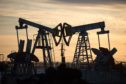 "Oil pumping jacks, also known as ""nodding donkeys"", operate in an oilfield near Almetyevsk, Tatarstan, Russia, on Wednesday, March 11, 2020. Saudi Aramco plans to boost its oil-output capacity for the first time in a decade as the world's biggest exporter raises the stakes in a price and supply war with Russia and U.S. shale producers. Photographer: Andrey Rudakov/Bloomberg"