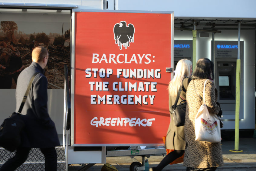 Handout photo issued by Greenpeace of a sign outside a Manchester branch of Barclays bank which they have closed down over the bankÕs support for fossil fuels. PA Photo. Picture date: Monday March 2, 2020. The environmental campaigners targeted almost 100 branches from Portsmouth to Dundee early this morning, shutting them down by disabling doors to prevent staff from entering. They demanding that Barclays stops its support for oil, gas and coal companies and channels funding into renewable energy instead to help tackle the climate crisis. See PA story ENVIRONMENT Barclays. Photo credit should read: Lucy Cartwright/Greenpeace/PA Wire  NOTE TO EDITORS: This handout photo may only be used in for editorial reporting purposes for the contemporaneous illustration of events, things or the people in the image or facts mentioned in the caption. Reuse of the picture may require further permission from the copyright holder.
