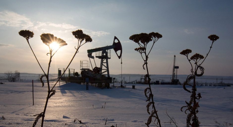An oil pumping jack, also known as a 'nodding donkey,' operates in a snow covered oilfield in the village of Otrada, 150kms from Ufa, Russia.