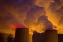Emissions rise from cooling towers at the Jaenschwalde lignite fired power plant, operated by Lausitz Energie Bergbau AG (LEAG), at night in Peitz, Germany, on Monday, Sept. 16, 2019. Policies being hammered out in Germany to slash carbon emissions may cost 40 billion euros ($44 billion) over the next four years, underscoring the wide scope of Chancellor Angela Merkel's plans to boost climate protection. Photographer: Krisztian Bocsi/Bloomberg