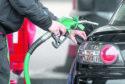A person using a petrol pump.