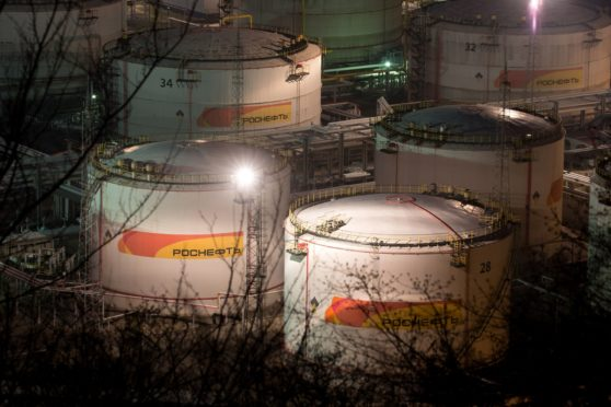 Lights illuminate oil storage tanks at night at the RN-Tuapsinsky refinery, operated by Rosneft Oil Co., in Tuapse, Russia, on Sunday, March 22, 2020. Major oil currencies have fallen much more this month following the plunge in Brent crude prices to less than $30 a barrel, with Russia's ruble down by 15%. Photographer: Andrey Rudakov/Bloomberg