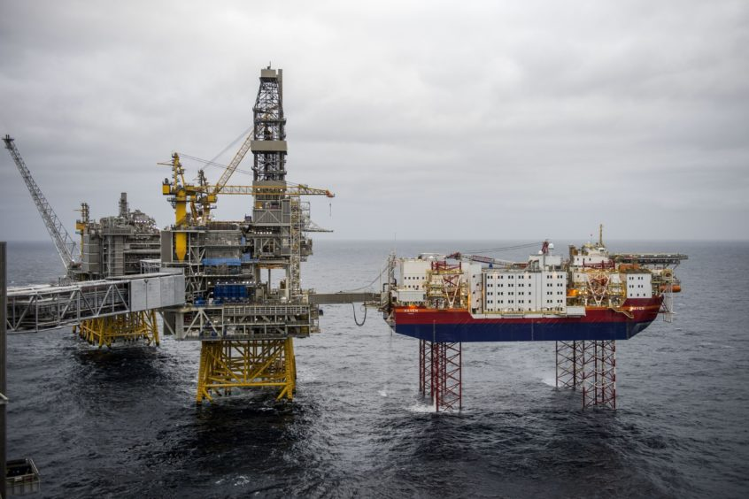 The Haven accommodation jackup rig, owned by Jacktel AS, right, stands connected to the drilling platform, center, on the Johan Sverdrup oil field off the coast of Norway in the North Sea, on Tuesday, Dec. 3, 2019. Sverdrup's earlier-than-expected start in October broke a long trend of underperformance for Norway's overall oil production. Photographer: Carina Johansen/Bloomberg
