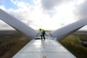 An employee prepares to exit the nacelle of a Vestas A/S V136 wind turbine during operational testing at the Danish National Test Center for Large Wind Turbines in Osterild, Denmark, on Monday, April 18, 2016.  Photographer: Chris Ratcliffe/Bloomberg