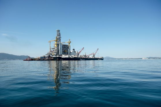 The H-627 barge carrier transports an oil drilling platform onto the world's largest construction vessel, the Pioneering Spirit, in the Bomla fjord near Leirvik, ahead of its transportation to the Johan Sverdrup oil field, Norway.
