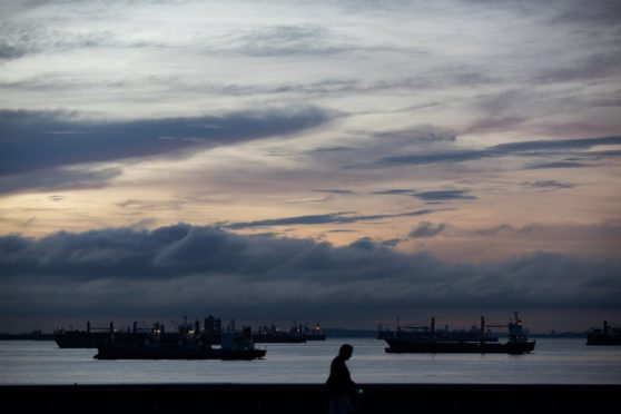 Ships sit moored at sunrise in Singapore, Singapore, on Monday, Feb. 10, 2020.  Photographer: Bloomberg/Bloomberg
