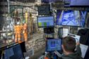 Workers monitor data on computer screens aboard the Maersk Invincible rig, operated by Maersk Drilling Services A/S, on the Valhall field in the North Sea off the coast of Stavanger, Norway, on Wednesday, Oct. 9, 2019. The boss of Maersk Drilling is in no rush to make acquisitions because he believes a rout in equity prices for offshore drillers has further to go. Photographer: Carina Johansen/Bloomberg