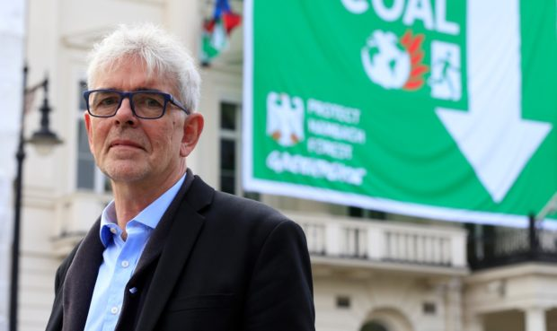 Greenpeace UK executive director John Sauven stands in front of the facade of the German embassy complex in London.