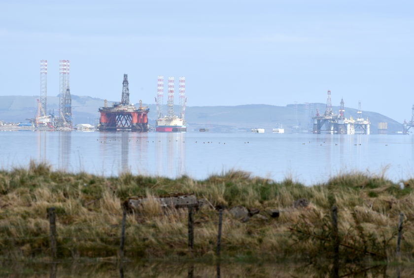 The Cromarty Firth is seeing an increasing number of oil rigs currently in the firth for storage. Photo by Sandy McCook, on April 10, 2020.