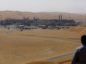 An employee looks out over the Natural Gas Liquids (NGL) facility in Saudi Aramco's Shaybah oilfield in the Rub' Al-Khali (Empty Quarter) desert in Shaybah, Saudi Arabia. Photographer: Simon Dawson/Bloomberg