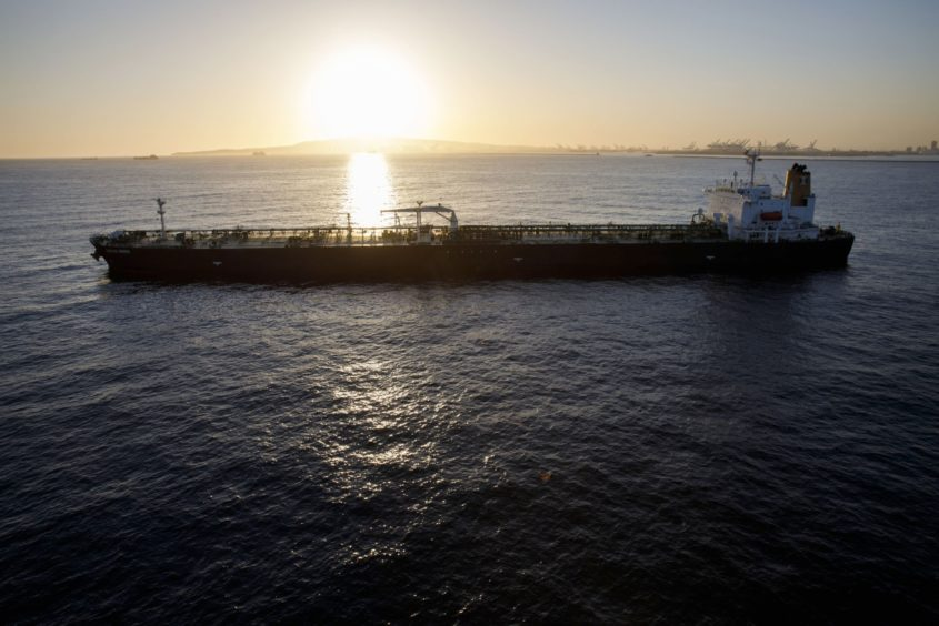An oil tanker is seen anchored in the Pacific Ocean in this aerial photograph taken above Long Beach, California, U.S., on Friday, May 1, 2020.  Photographer: Patrick T. Fallon/Bloomberg