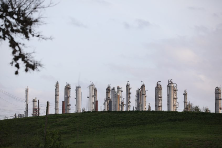 A refinery stands next to Charles H. Milby Park in Houston, Texas, U.S., on Sunday, March 8, 2020. Houston has been purposefully going green for more than a decade. The municipal government gets 92% of all the power it uses in the buildings it owns from wind and solar and has been on the U.S. Environmental Protection Agency's list of the largest renewable power users since 2016. Photographer: Sharon Steinmann/Bloomberg