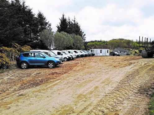 Cars of workers parked outside RTS Ltd's cabin base at the Limekiln wind farm site near Reay. Iain Grant.