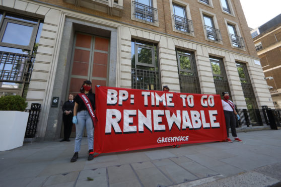 Greenpeace activists stage a socially distanced protest outside BP's Annual General Meeting, which is being broadcast from their London headquarters.  Pic: Greenpeace