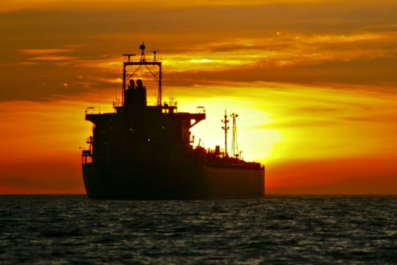 An oil tanker is anchored near the Port of Long Beach, California, U.S. Photographer: Tim Rue/Bloomberg