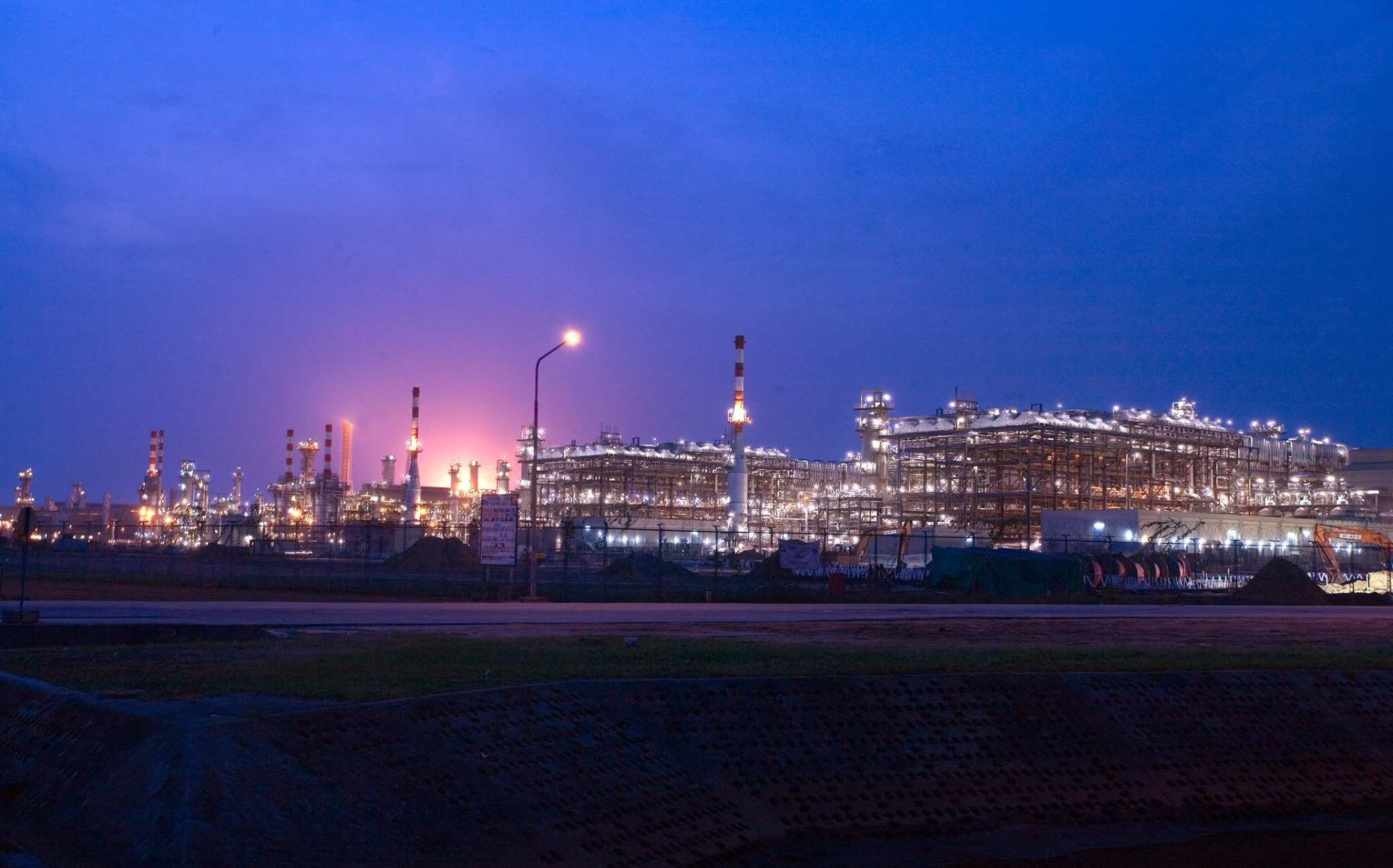 Industrial plant at night against dark blue sky