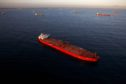 Oil tankers are seen anchored in the Pacific Ocean in this aerial photograph taken above Long Beach, California, U.S., on Friday, May 1, 2020. The volume of oil on vessels located just offshore the state peaked at 26 million barrels over the weekend, about a quarter of the world's daily consumption, before dropping to 22 million barrels on Monday, according to Paris-based Kpler SAS, which tracks tanker traffic. Photographer: Patrick T. Fallon/Bloomberg