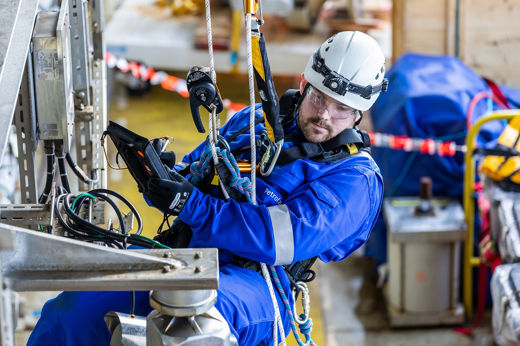 An offshore worker carrying out inspection duties.