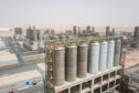 Processing tanks stand at the Ruwais refinery and petrochemical complex, operated by Abu Dhabi National Oil Co. (ADNOC), in Al Ruwais, United Arab Emirates, on Monday, May 14, 2018. Adnoc is seeking to create world's largest integrated refinery and petrochemical complex at Ruwais. Photographer: ChristopheViseux/Bloomberg
