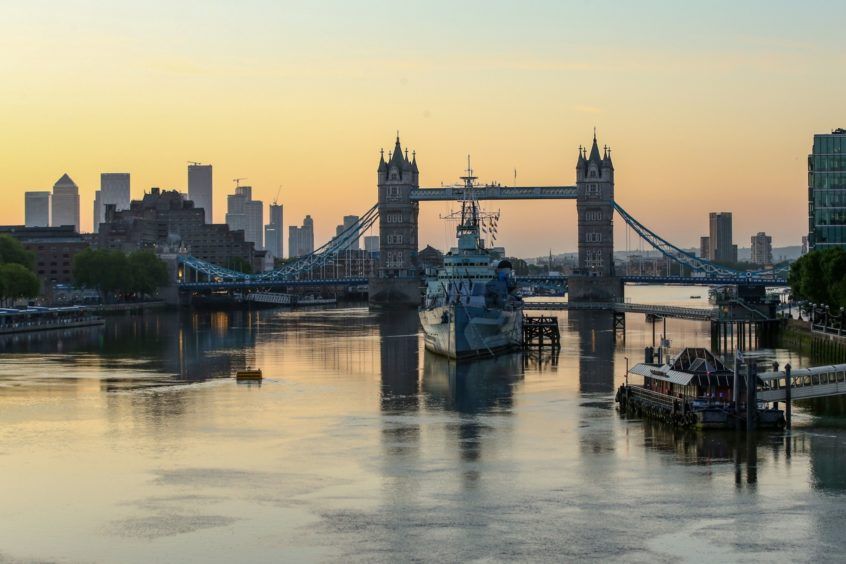 The sun rises beyond Tower Bridge in London, U.K., on Friday, May 29, 2020. For the last 11 weeks, Europe's financial center has been staffed with skeleton crews, particularly on the high-speed trading desks that are difficult to run from home. Photographer: Hollie Adams/Bloomberg