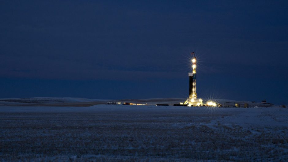A rig stands at night in the Bakken Formation outside Watford City, North Dakota.