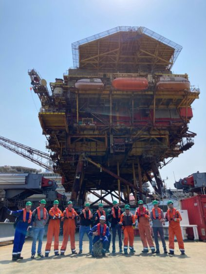 "Allseas - ""Brent Alpha is undertow to Able UK's Teesside yard for recycling after a successful transfer to Allseas' cargo barge Iron Lady. Here's the team that made it all possible. Well done guys!"""
