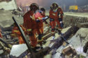 Firefighters look for residents trapped in collapsed buildings in the aftermath of a tanker truck explosion near a highway in Wenling in eastern China's Zhejiang province Saturday, June 13, 2020. More than a dozen were killed and others injured after the tanker truck veered off the Shenyang-Haikou Expressway after the explosion. (Chinatopix via AP)
