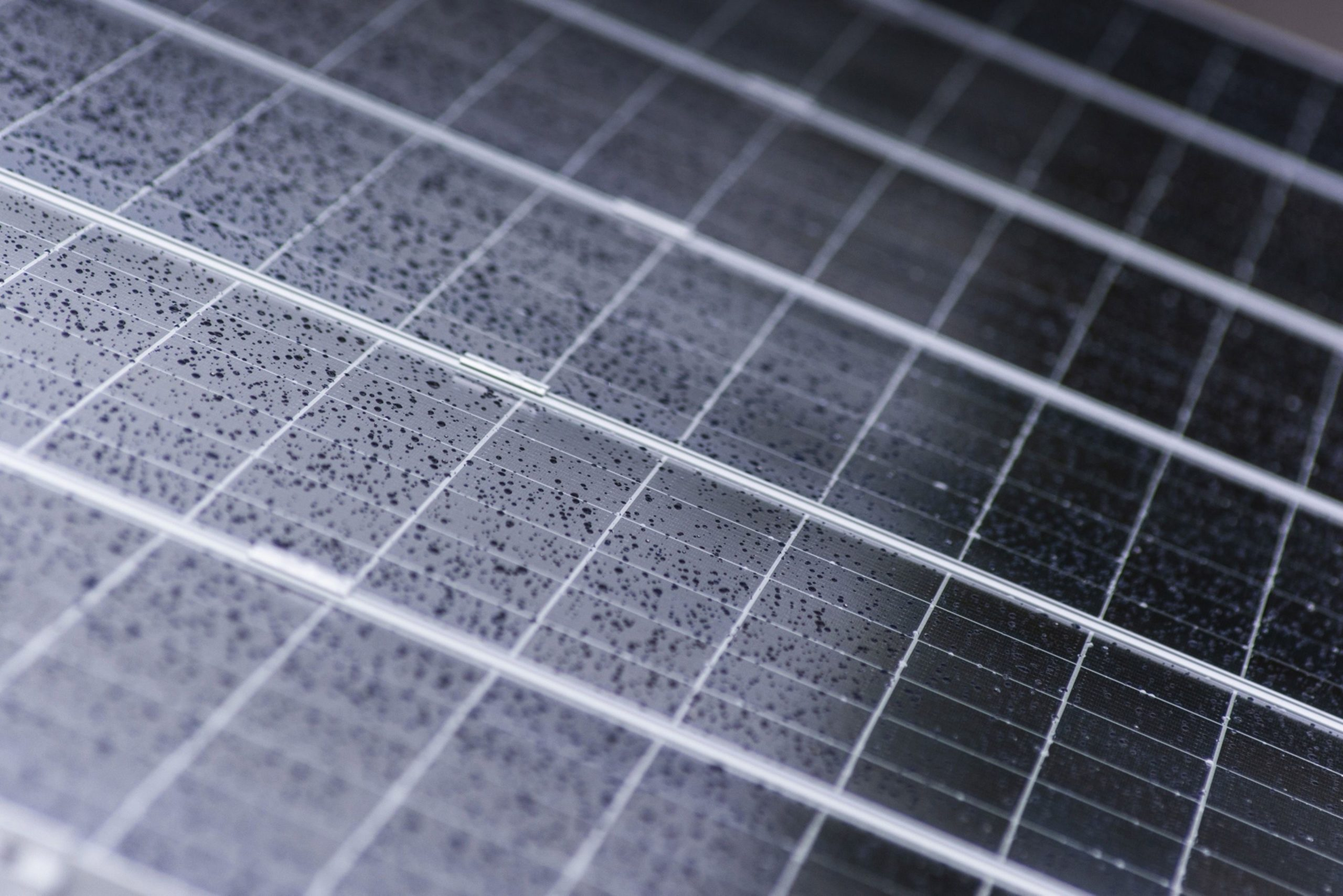 Rain droplets cover solar panels installed on the roof of a residential property in Johannesburg, South Africa, on Friday, Mar. 13, 2020.