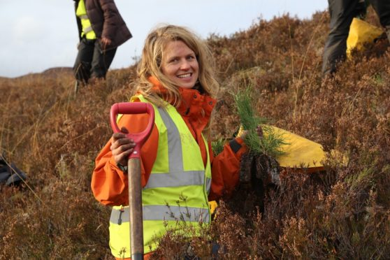 Volunteer Katy with Scots pine seedlings she's about to plant