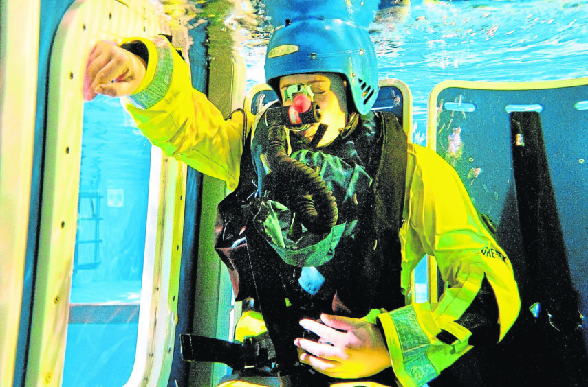 Offshore worker carries out helicopter safety training at Survivex.