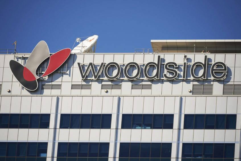 The Woodside Petroleum Ltd. logo is displayed atop the Woodside Plaza building, which houses the company's headquarters, in the central business district of Perth, Australia.
