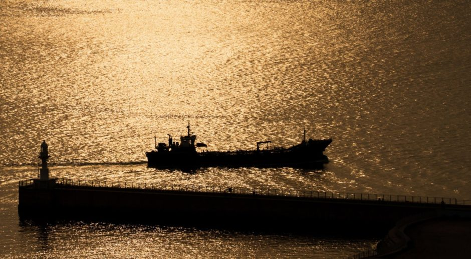 A ship sails past the lighthouse at sunset in the Port of Incheon in Incheon, South Korea, on Monday, Sept. 4, 2017. President Donald Trump said he would discuss the future of the U.S.-South Korea free-trade agreement with his advisers following a newspaper report that hes considering terminating the pact. Photographer: Bloomberg/Bloomberg